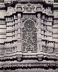 Close view of carved stone niche at the base of the minaret of the Nagina Masjid, Champaner 1862